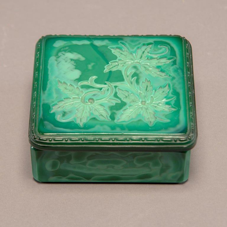 Deco era Czech malachite glass lidded box with leaf design. Unknown maker and pattern. Excellent overall vintage condition.