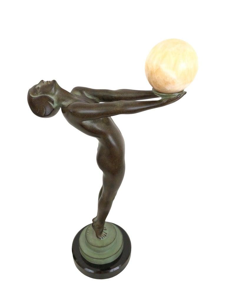 Patinated Art Deco Dancer Sculpture Lueur with Onyx Ball Original Max Le Verrier France For Sale