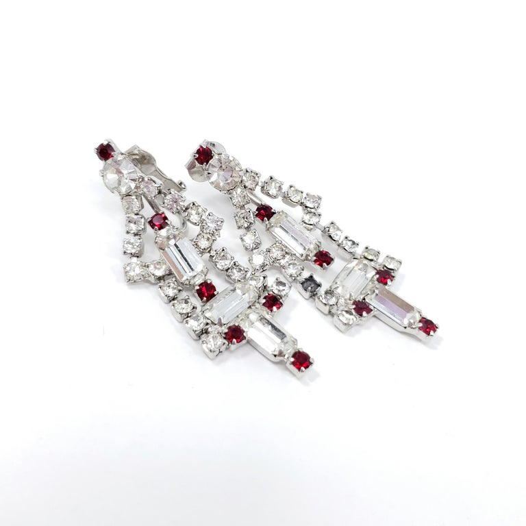 Stylish, glittering art-deco clip on earrings. Round and baguette-cut crystals, prong-set in a dangling deco setting.  Silver-tone.