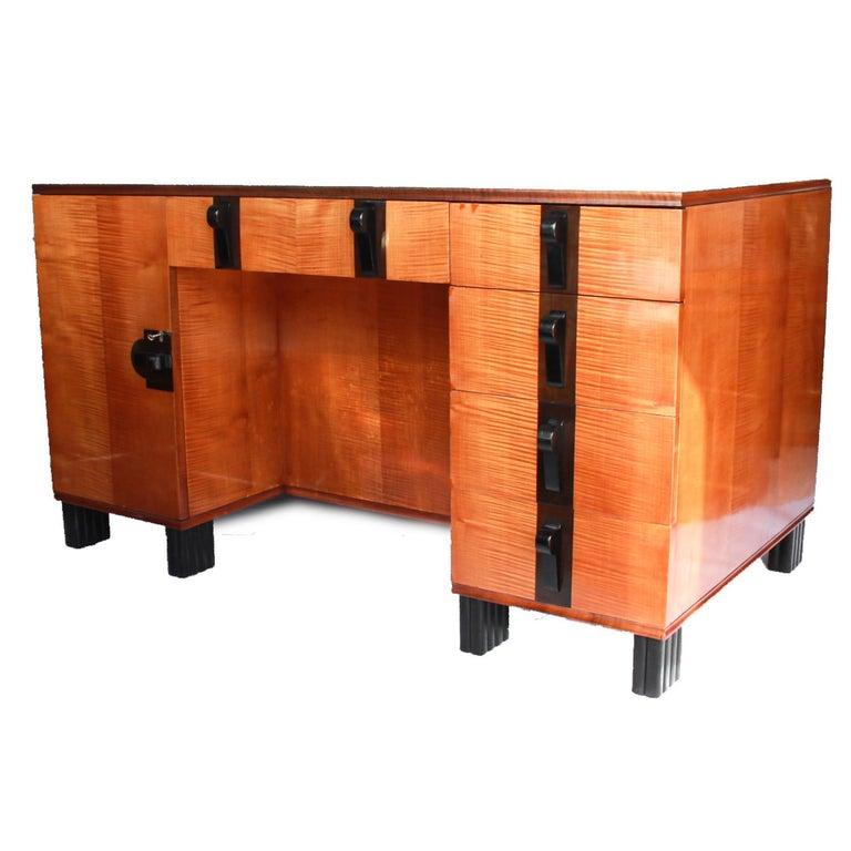 An Art Deco, Maurice Adam satin wood and ebony desk. Original handles with ebony banding too front. Original ebony fluted feet.