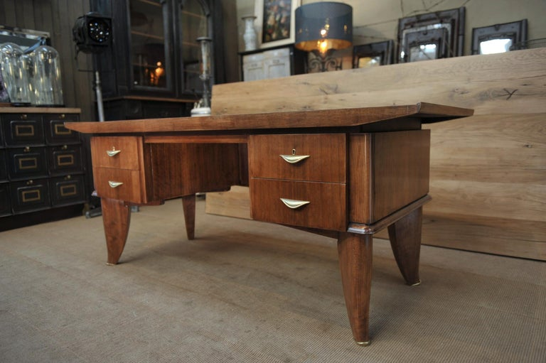 Art Deco 4 drawer desk by  Sanyas & Popot, France in walnut wood and bass handles and feet excellent condition, circa 1930.