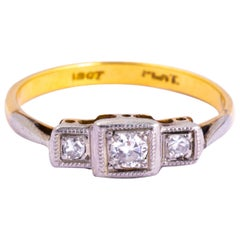 Art Deco Diamond, 18 Carat Gold and Platinum Three-Stone Panel Ring