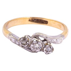 Art Deco Diamond, 9 Carat Gold and Platinum Cross Over Three-Stone Ring