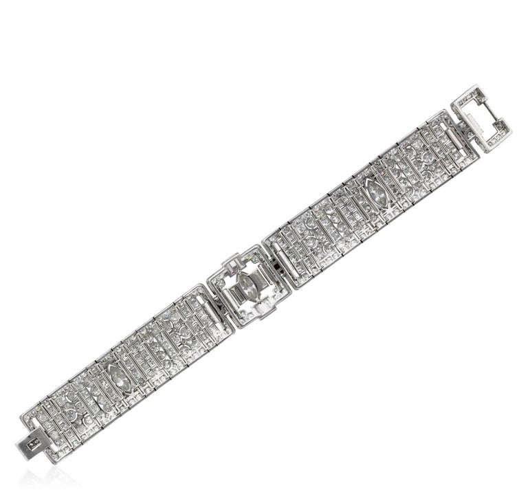 This Platinum Art Deco bracelet is featured with openwork of articulated design.  It is enhanced with 306 round brilliant cuts and 10 single-cut diamonds with an approximate total weight of 11.00 carats, 3 marquise shaped diamonds weighing