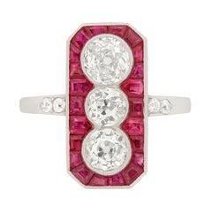 Art Deco Diamond and Ruby Three-Stone Halo Ring, circa 1920s