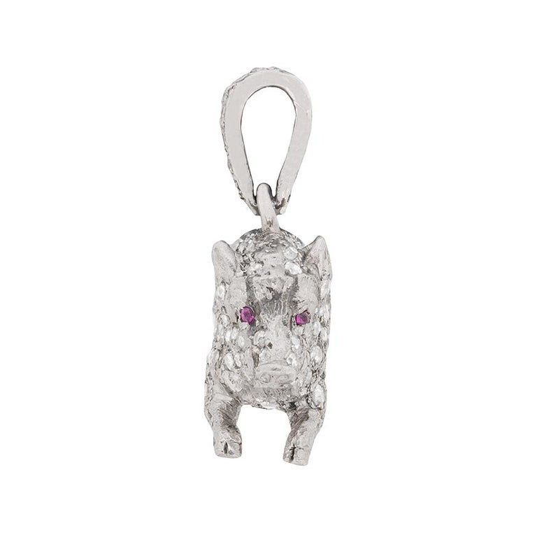 A stunning pendant, all handcrafted from platinum, featuring grain set old cut diamonds all over. There is a total of 2.80 carat, which have been perfectly and expertly set across the body, back and head of this delicate little boar pendant. They