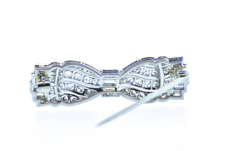 Baguette Cut Art Deco Diamond Bow Brooch, circa 1930 For Sale