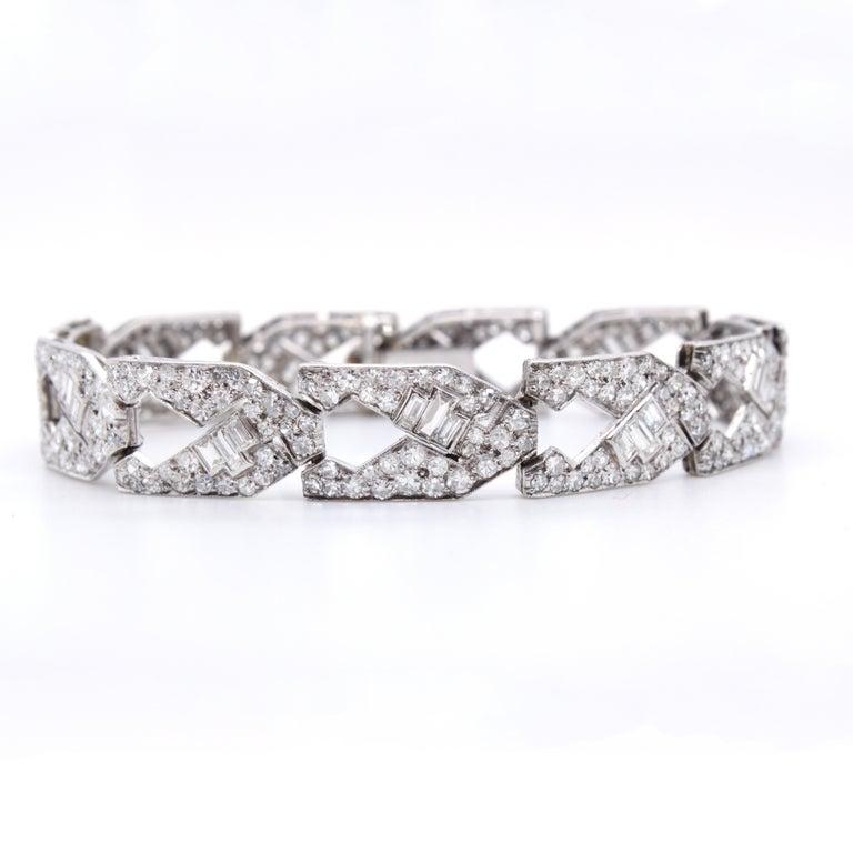 Art Deco Diamond Bracelet, ca. 1930s  A beautiful Art Deco diamond bracelet of 11 links with round and step cut diamonds of circa 13 carats.  Length 17 cms Made in platinum.