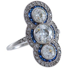 Art Deco Diamond Calibre Cut Sapphire and Platinum Ring