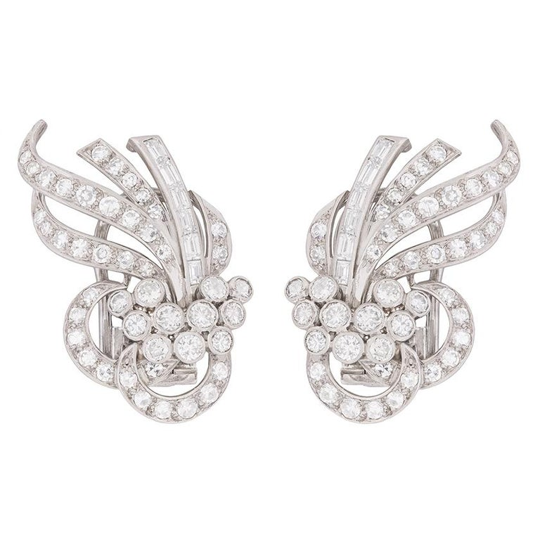 Stunning, fabulous and exotic! These earrings date back to the 1920s and are a wonderful example of the high fashion dress earrings from the era. They feature a collection of baguette cut, transitional cut and eight-cut diamonds, with each earring