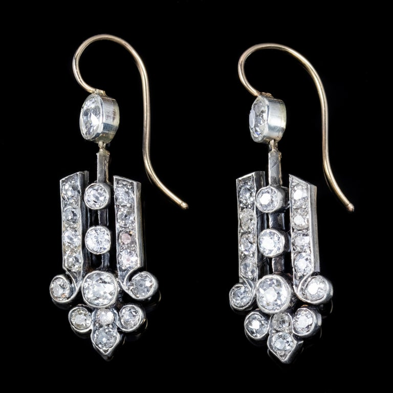 A spectacular pair of Art Deco drop earrings decorated with beautiful quality old European cut Diamonds with approx. 1.50ct in each earring, 3ct in total.   The Old Cut Diamonds sparkle with immense fire and life and are known to Dance by