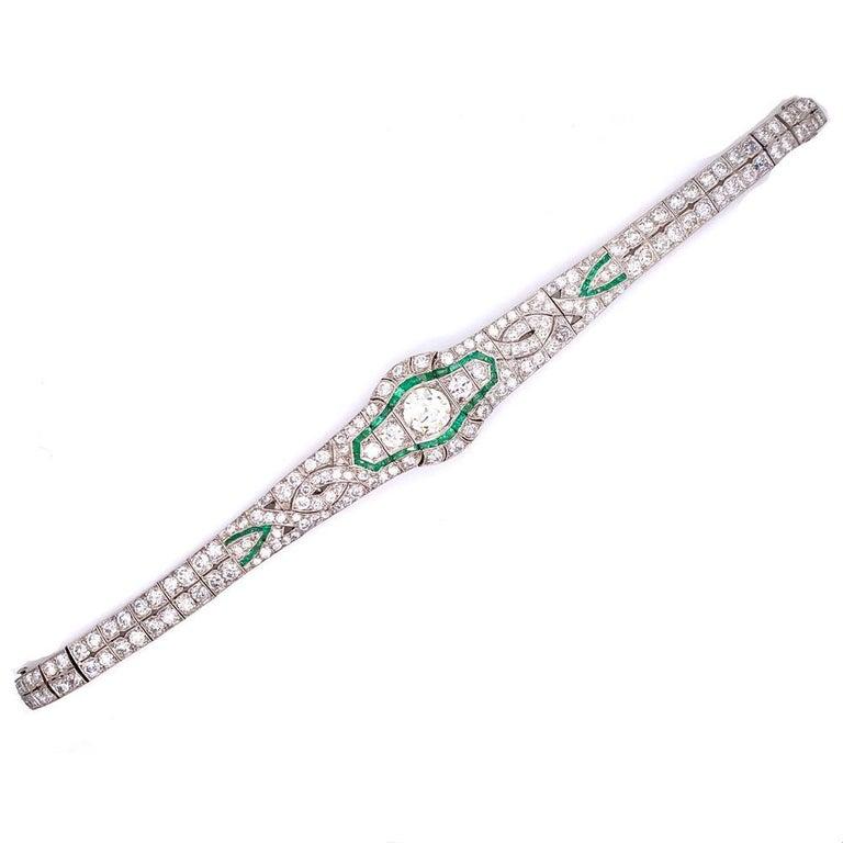 Gorgeous Art Deco Diamond Emerald Platinum Bracelet. This original Deco bracelet features a center 1.65 carat Old European Cut diamond graded K color and VS2 clarity. Another 8.50 carat of Old European cut diamonds are set with emerald accents in