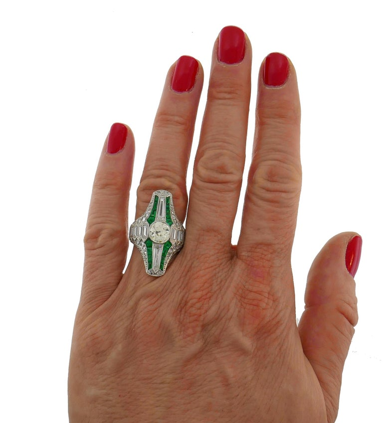 Classic Art Deco ring. Elegant, timeless and feminine, the ring is a great addition to your jewelry collection.  Made of platinum, the ring features an old cushion cut diamond (1.60-carat, O-P color and VS21 clarity). The beautiful setting has 1.37