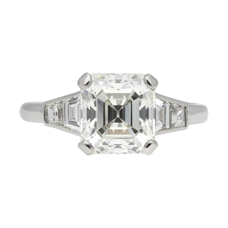 Art Deco Diamond Flanked Solitaire Ring, circa 1925 For Sale