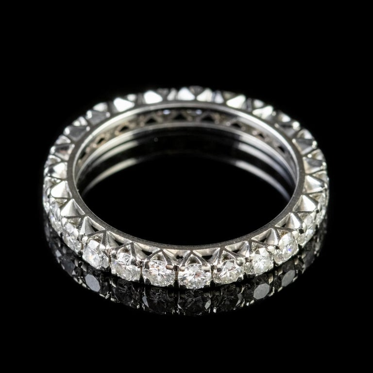 A stunning Art Deco full eternity ring lined with superb SI1 clarity Diamonds which sparkle with immense beauty around the outer circumference totalling to approx. 1.70ct.   Eternity rings have been given as a love token throughout history with