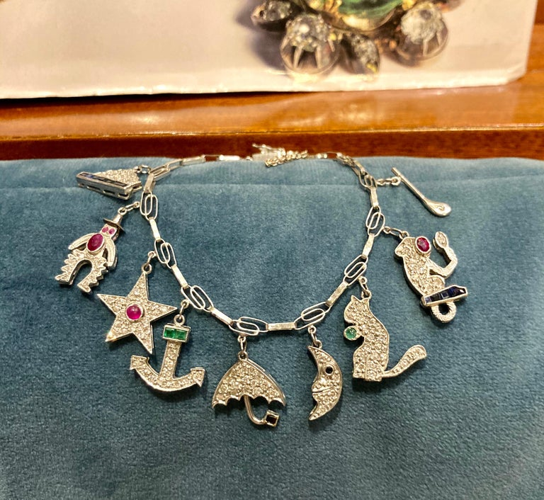 Mixed Cut Art Deco Diamond and Gemstone White Gold Charm Bracelet For Sale