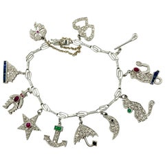 Art Deco Diamond and Gemstone White Gold Charm Bracelet