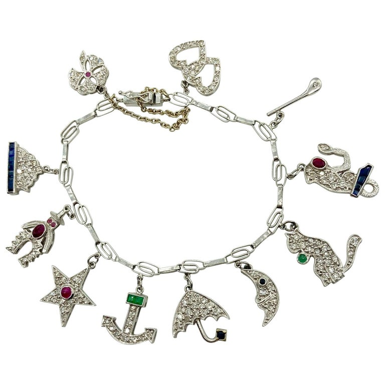 Art Deco Diamond and Gemstone White Gold Charm Bracelet For Sale