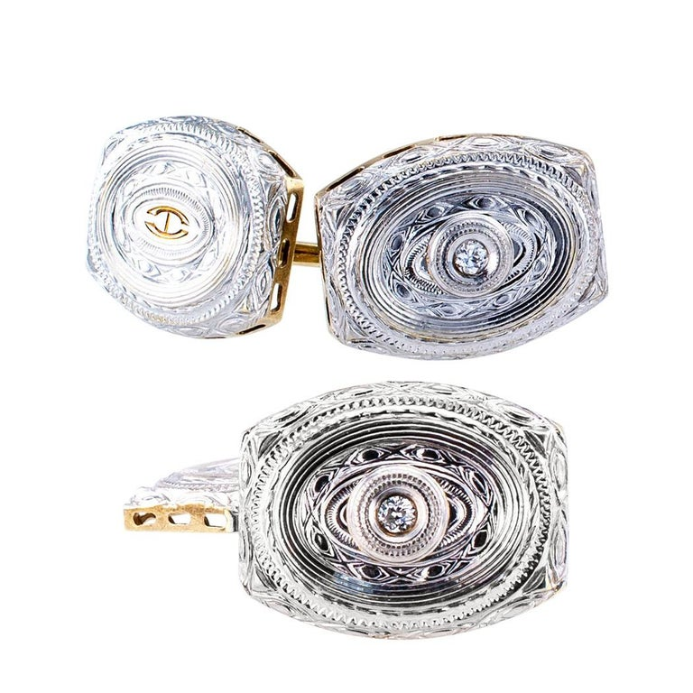 Art Deco diamond and gold double sided gold cufflinks circa 1920. The matching designs feature lavishly engraved and chased front surfaces, two of them centering upon a small round diamond, together totaling approximately 0.04 carat, approximately