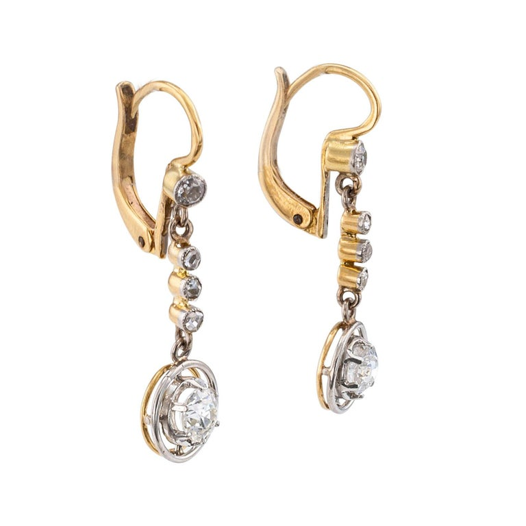 Art Deco diamond drop earrings. DETAILS: Art Deco diamond gold and platinum drop earrings circa 1930. DIAMONDS: two old European-cut diamonds together weighing approximately 0.60 carat, approximately H – J color and VS – SI clarity, two smaller old
