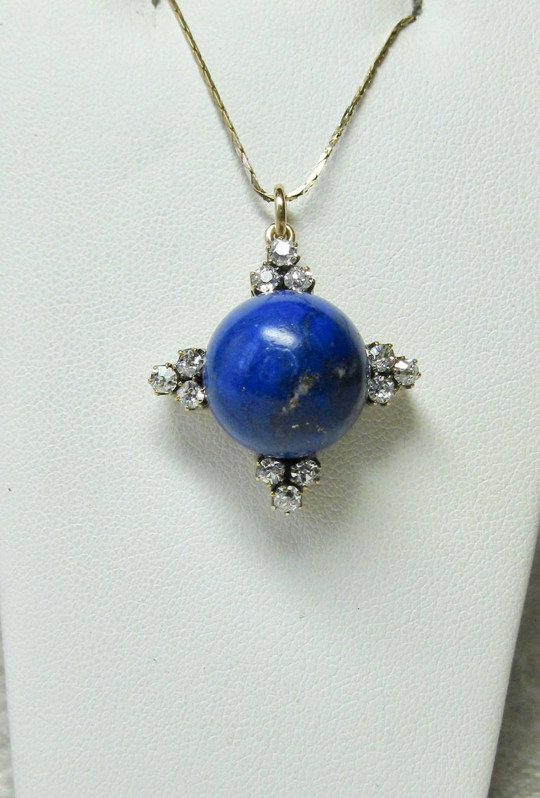 A stunning Antique Art Deco - Victorian Pendant with a gorgeous central 16 Carat Lapis Lazuli sphere set with 12 absolutely radiant Old Mine Cut Diamonds totaling approximately 1.2 Carat.  The sparkling white antique diamonds are G-H color - very