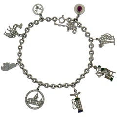Art Deco Diamond Platinum Charm Bracelet with Gemstones and Enamel, 1920s