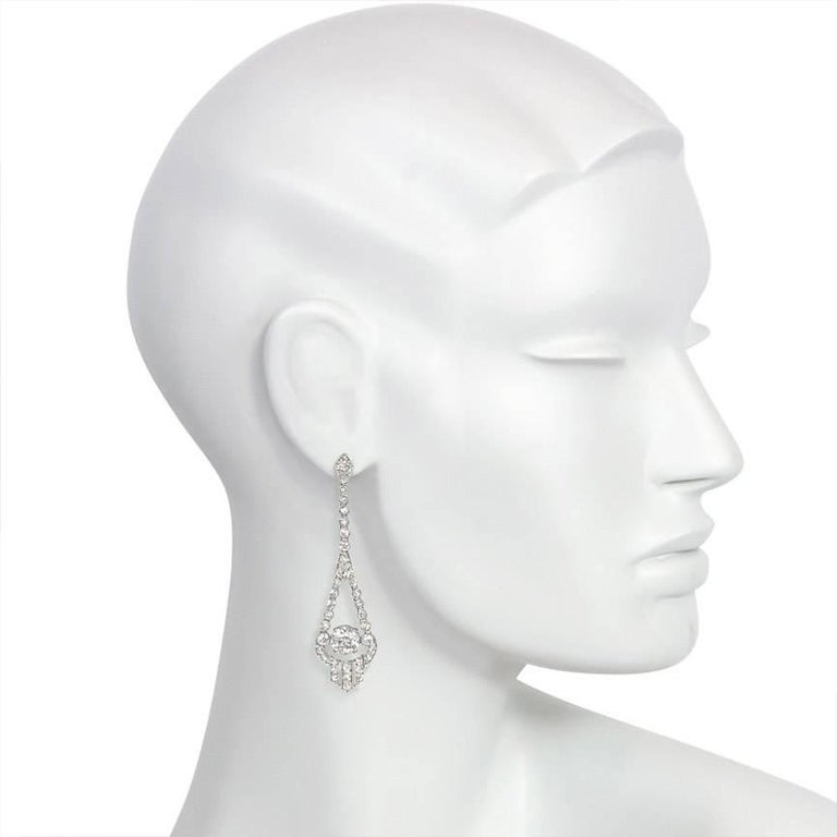 A pair of Art Deco diamond earrings with collet-set old mine and rose cut diamonds, each centering on an old European cut diamond of approximately 2.00 cts. in a shield-shaped panel, in platinum.  Estimated total weight 7.90 cts.