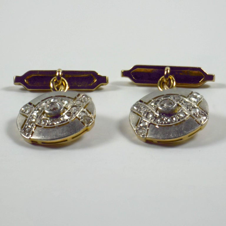 A chic pair of cufflinks in platinum topped 18 karat gold set with 32 rose-cut diamonds and two old cut diamonds with a total approximate weight of 1 carat.  The cufflinks are unmarked but have been tested.  Measurements: diamond set link: 1.3 x
