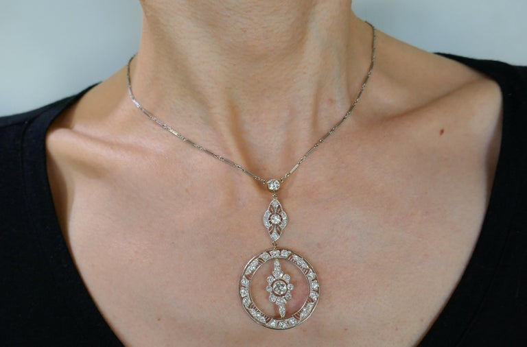 Classy Art Deco diamond and platinum necklace. Elegant and timeless, the necklace is a great addition to your jewelry collection. Made of platinum (tested) and set with Old European cut diamonds (I-K color, VS clarity. Three larger diamonds weigh