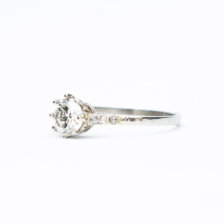 A magnificent example of an Art Deco Diamond solitaire ring, beautifully set with diamond shoulders in an eighteen carat white gold setting. The central Old European Cut diamond measures approximately 1 point 15 carats, G/H in colour and VS2/SI-1 in