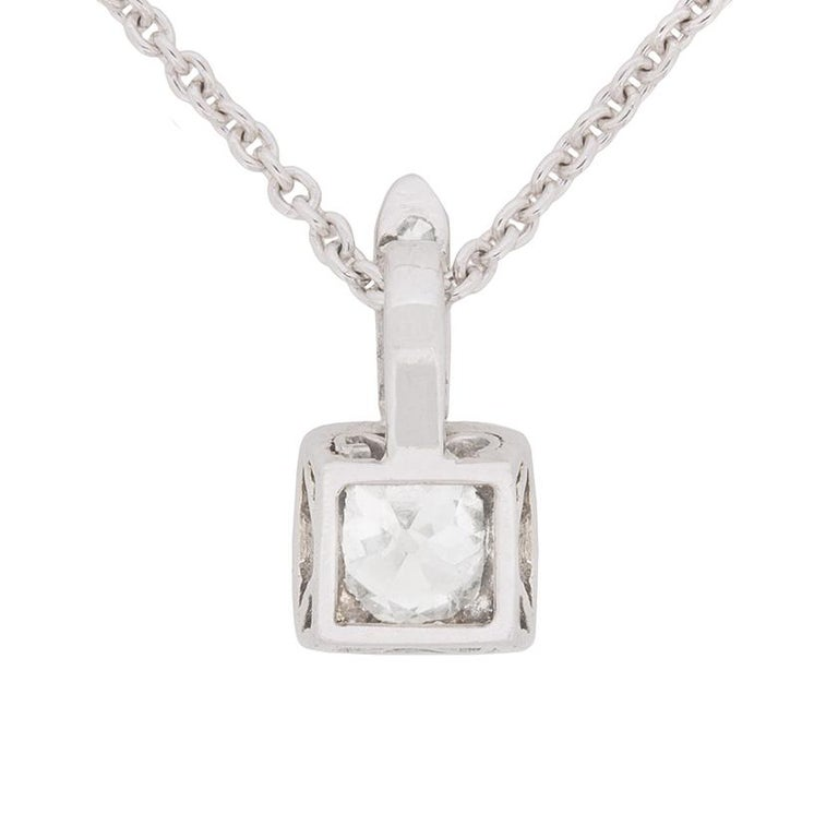 This delicate pendant features a 0.61 carat old cut diamond which is a cushion cut. It is a H in colour and SI1 in quality and is grain set beautifully within a platinum collet. On the bail are a further three diamonds weighing 0.03 carat in total.