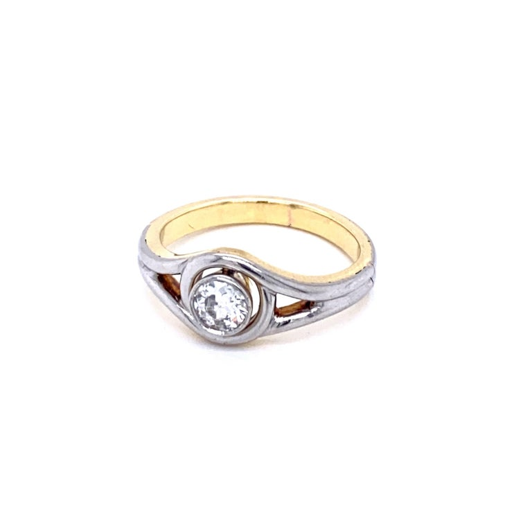 Simple and Beautiful unisex bicolor ring made of Platinum and 18k yellow Gold, origin Italy circa 1940.  It is set with one full of charme sparkling old mine cut Diamond of approx. .50 carat Graded G color Vs clarity.  CONDITION: Pre-Owned -
