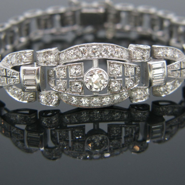 This beautiful bracelet comes directly from the Art Deco era. It is fully made in 18kt white gold and platinum. It features 118 diamonds – 110 are old European cut and 8 are baguettes. The centre diamond weighs 0.60ct approximately and the total