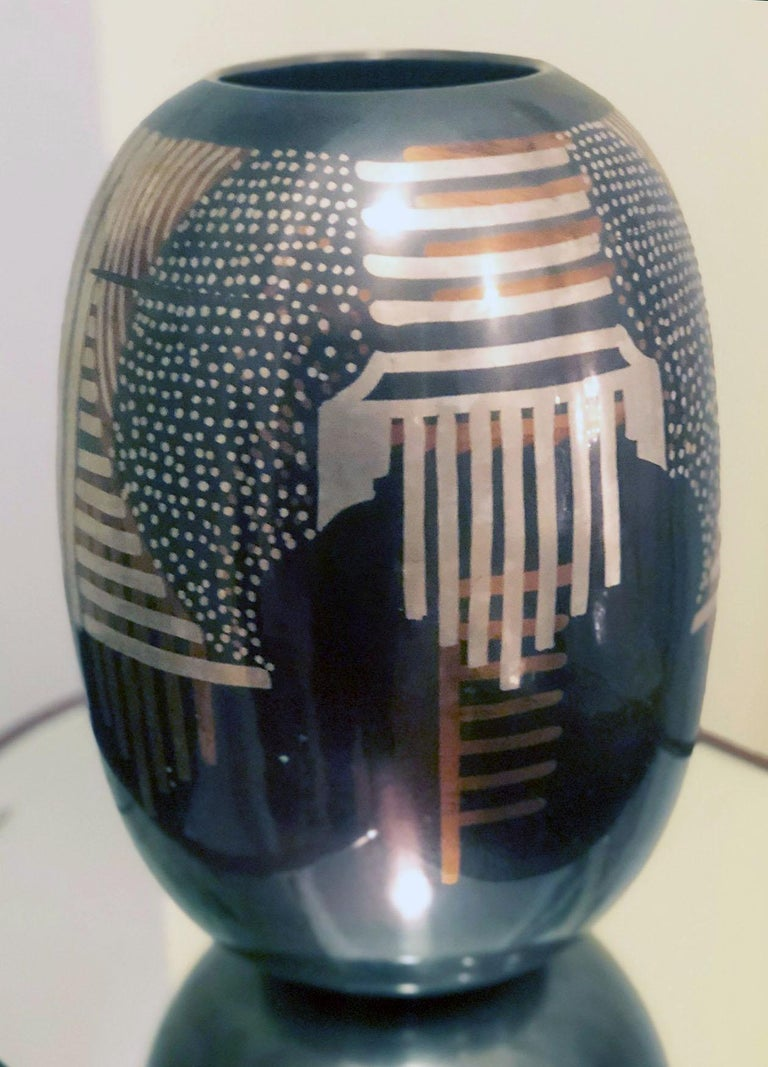 Art Deco dinanderie vase in the manner of Dunand, unsigned. Measures: Height 11