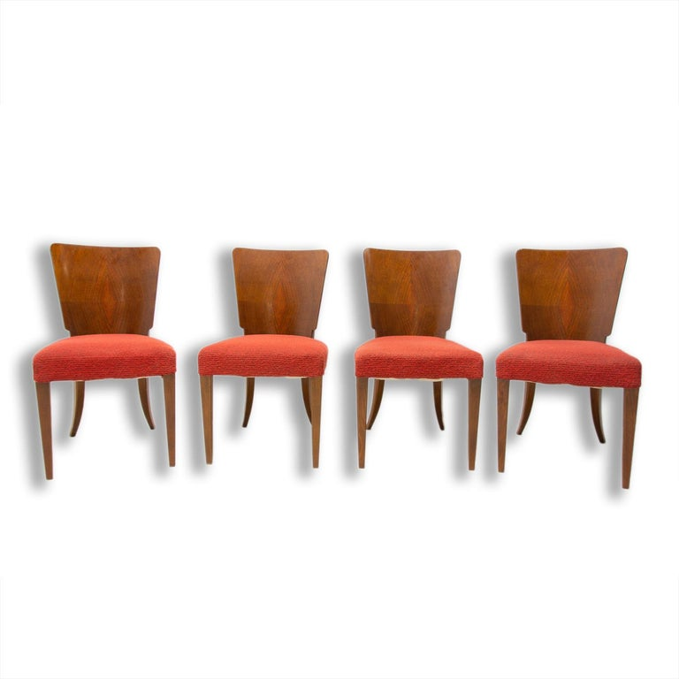 Set of four dining chairs, catalog number H-214, designed by Jindrich Halabala in the 1930´s, manufactured in ÚP Závody in the 1950´s. It features walnut veneer and original upholstery. The chairs are in very good Vintage condition. Price is for the