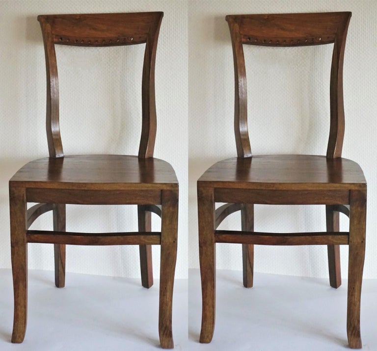 Four Art Deco solid Oak dining chairs in elegant design with curved back providing comfortable support, late 1930s  Height 35 in (89 cm) Width 17.75 in (45 cm)  Depth 17.75 in (45 cm) Seat height 18 (45.5 cm).