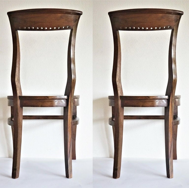 Four Art Deco solid oak dining chairs in elegant design with curved back providing comfortable support, late 1930s. Measures: Height 35 in (89 cm) Width 17.75 in (45 cm) Depth 17.75 in (45 cm) Seat height 18 (45.5 cm).