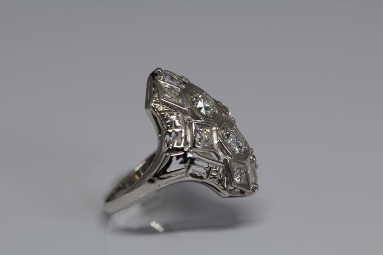 Art deco jewellery is known for its bold lines and geometric shapes, quite a change from the delicate, and lacey edwardian era jewels that came before it but not any less stunning.  This ring is in the art deco style and made from 14 karat white