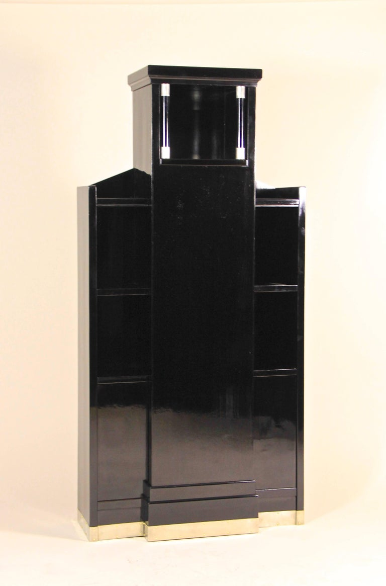 Rare design Art Deco display cabinet from the early 20th century in Austria. This architectural cabinet was built circa 1920 and shows the transition from Art Nouveau to the early Art Deco period in perfection. The unusual lines, reminding on a
