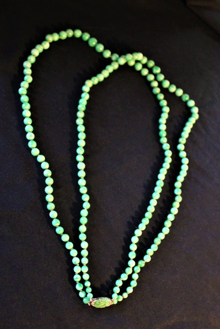 Chinese Art Deco Double Strand Jade Graduated Bead Necklace with 18-Karat Gold Clasp For Sale