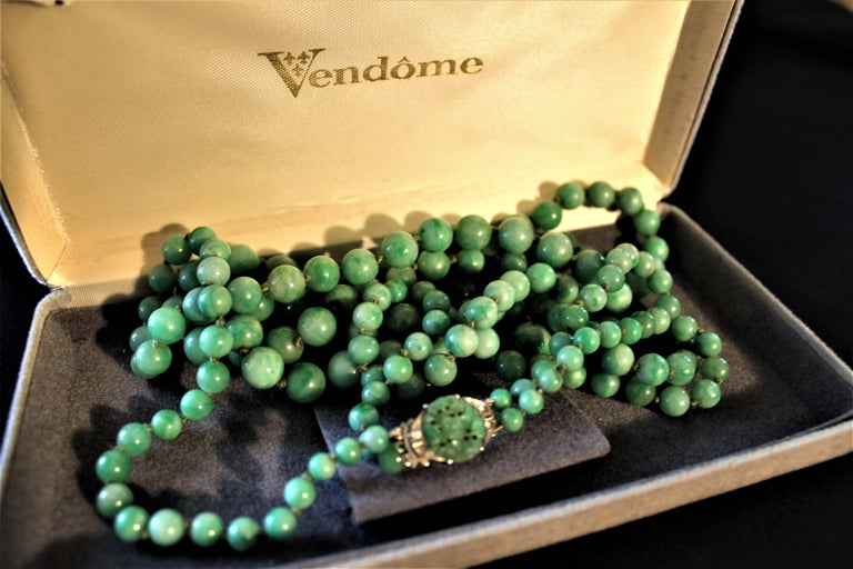 Early 20th Century Art Deco Double Strand Jade Graduated Bead Necklace with 18-Karat Gold Clasp For Sale