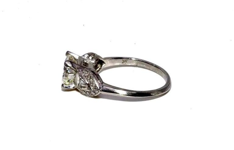 Round Cut Art Deco EGL Certified Center 1.31 Carat Diamond J/VS2 Platinum Engagement Ring For Sale