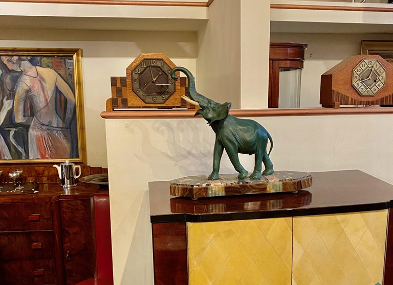 Art Deco elephant sculpture on marble stylized base. Spelter metal with ivoroid ( synthetic) tusks, in the lucky position of going upward. This is a great piece, showing style and movement, the best way to preserve the beauty of these magnificent