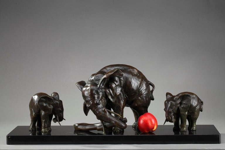 Bronze statue with dark brown patina featuring an elephant and its two baby elephants. The group rests on a black marble base. This bronze animal sculpture is signed: Caputo Bronze. Art Deco period.  Ulisse Caputo (1872-1948) is a Neapolitan