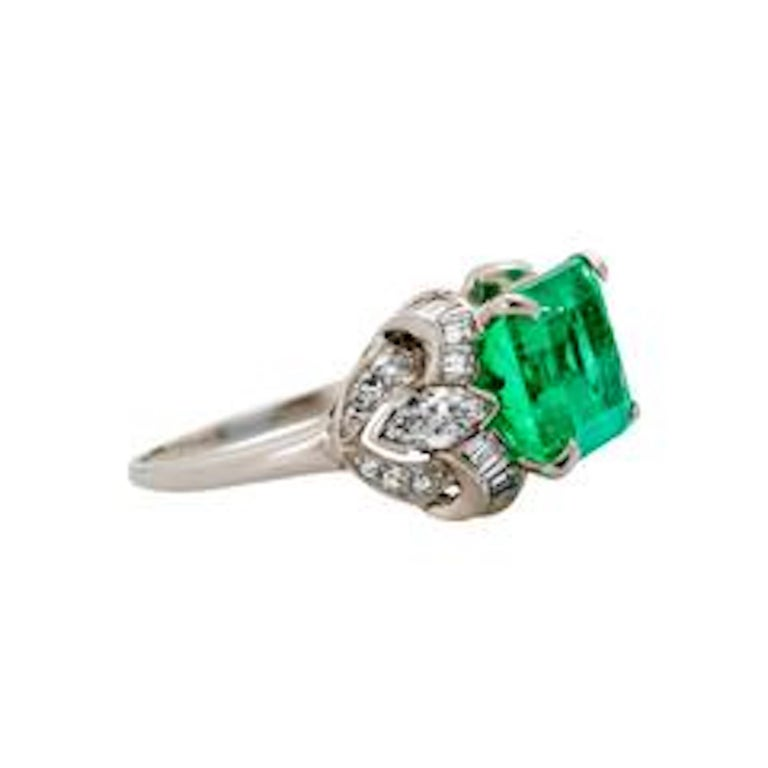 Kentshire is a spectacular platinum, diamond and natural emerald evening ring from the Art Deco era circa 1935. The ring features a magnificent GIA certified 4.97ct Columbian emerald measuring 11.38 x 9.22 x 6.60 mm. The beautiful center stone is