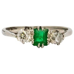 Art Deco Emerald and Diamond Platinum Three-Stone Ring
