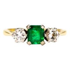 Art Deco Emerald and Diamond Three 18 Carat Gold Stone Ring