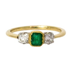 Vintage Emerald and Diamonds Three-Stone 18 Karat Yellow Gold Ring