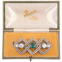 Art Deco Emerald Diamond and Platinum Brooch, circa 1930