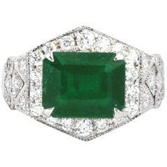Art Deco Style Emerald with Diamond 0.58 Carat Ring Set in 18 Karat White Gold